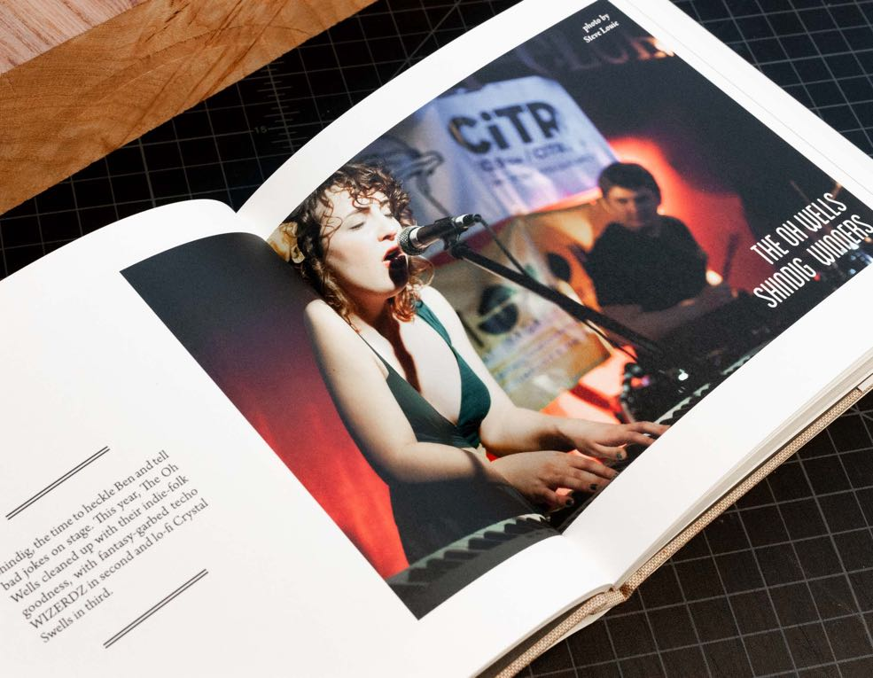 Annual Report for CiTR radio featuring a double page spread of Sarah Jickling the lead singer of 'The Oh Wells' — by Yagnyuk.