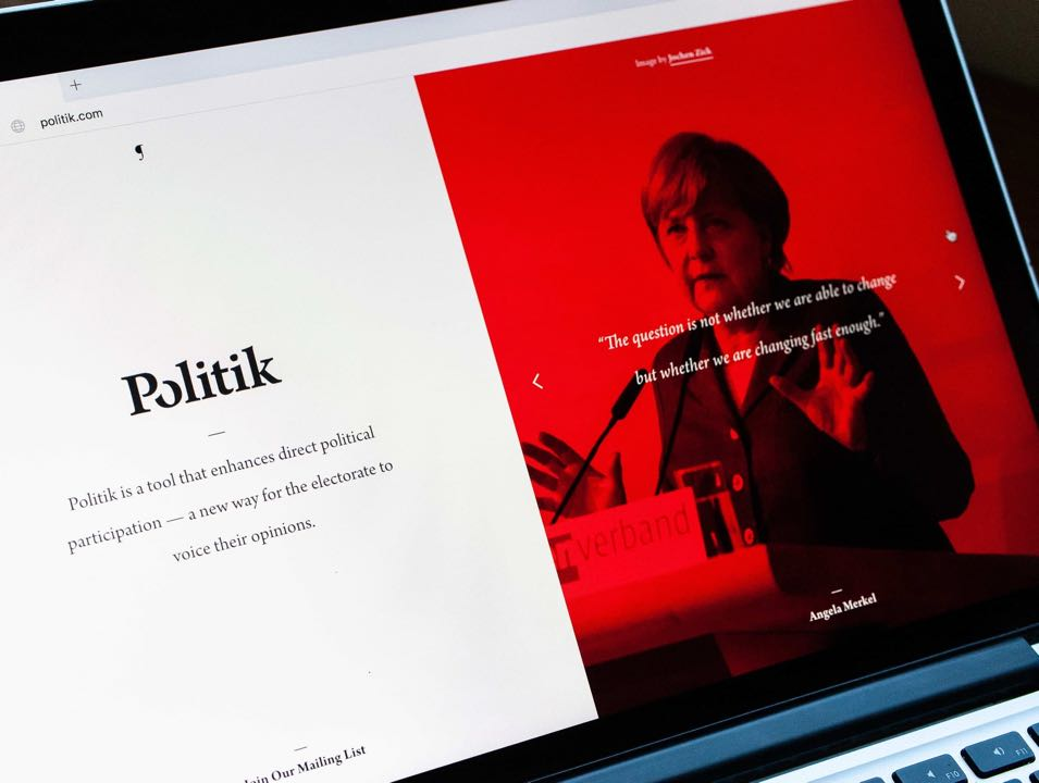 Pilcrow Politik home page in two column layout with photo of Angela Merkel — by Yagnyuk.