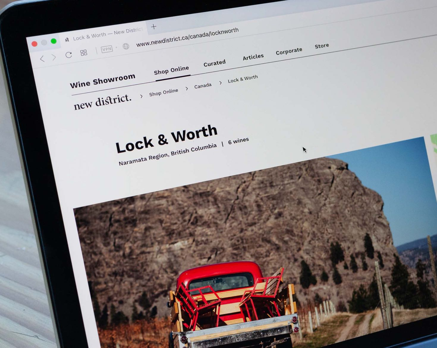 New District E-Commerce winery page for Lock&Worth with large photo of a red truck against a mountain backdrop — by Yagnyuk.