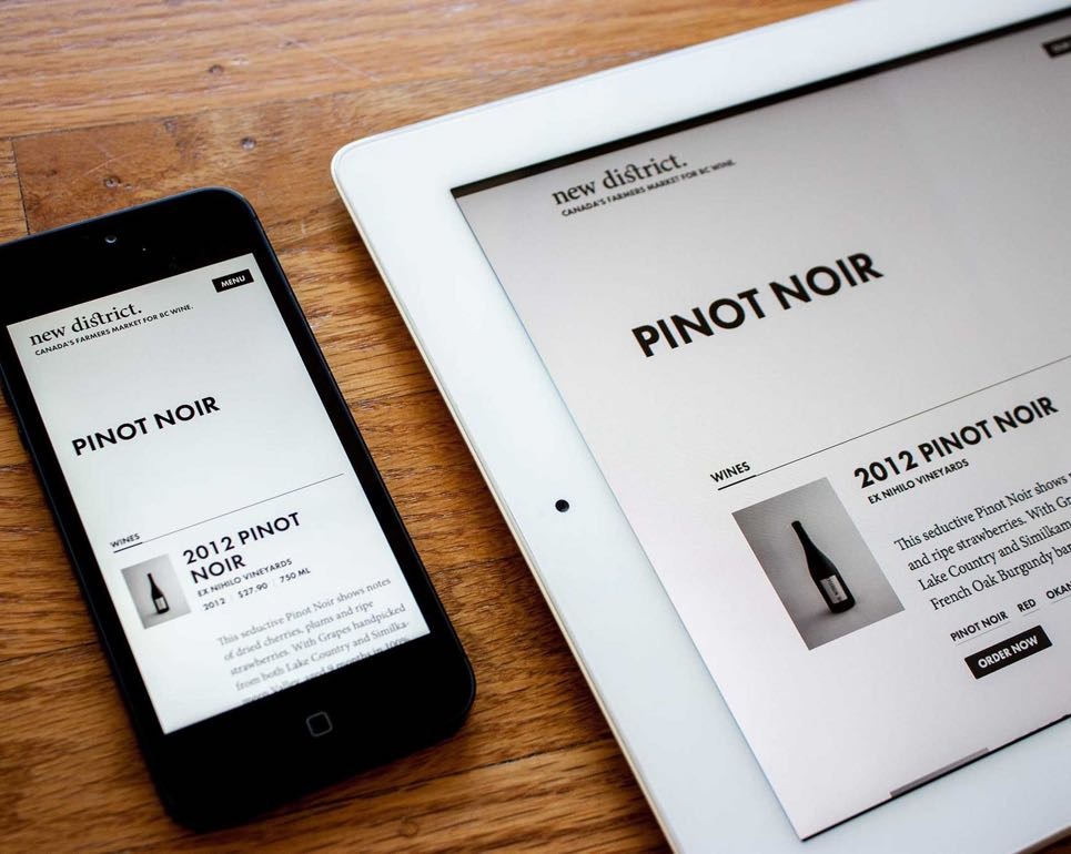 New District travel e-commerce interface showing Pinot Noir search results on mobile and tablet devices — by Dima Yagnyuk.
