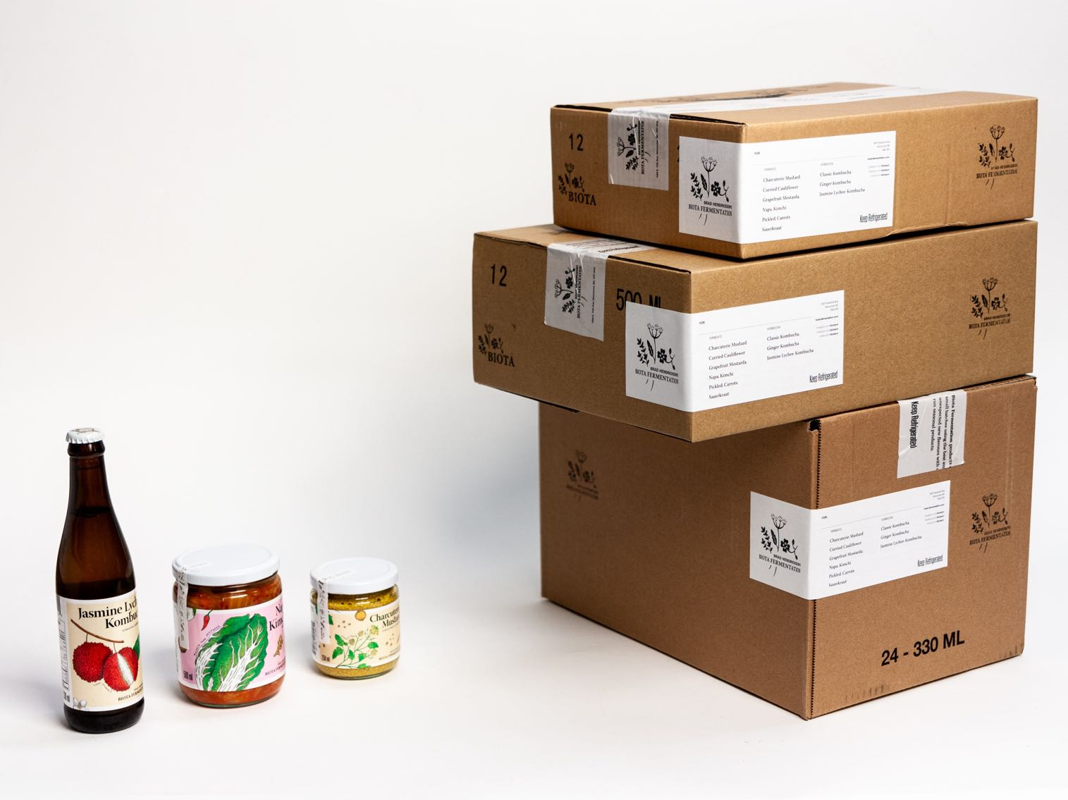 Biota Fermentation Craft Shipping boxes with Custom branded tape, labels, and ink stamping creating a contrasting color, visually pleasing, informationally clear shipping box  — by Dima Yagnyuk.
