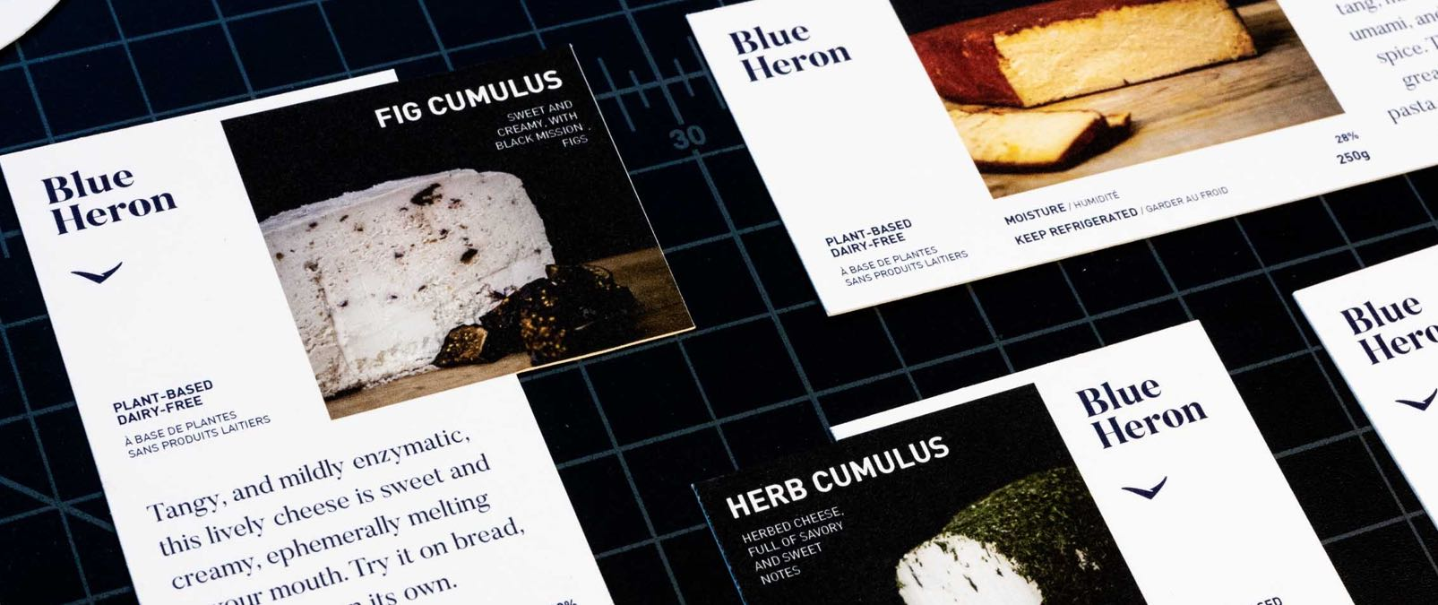 Blue Heron Cheese Labels, featuring prominent photography of Fig and Herb Cumulus featuring flavour descriptions by chef Karen McAthy — by Yagnyuk.