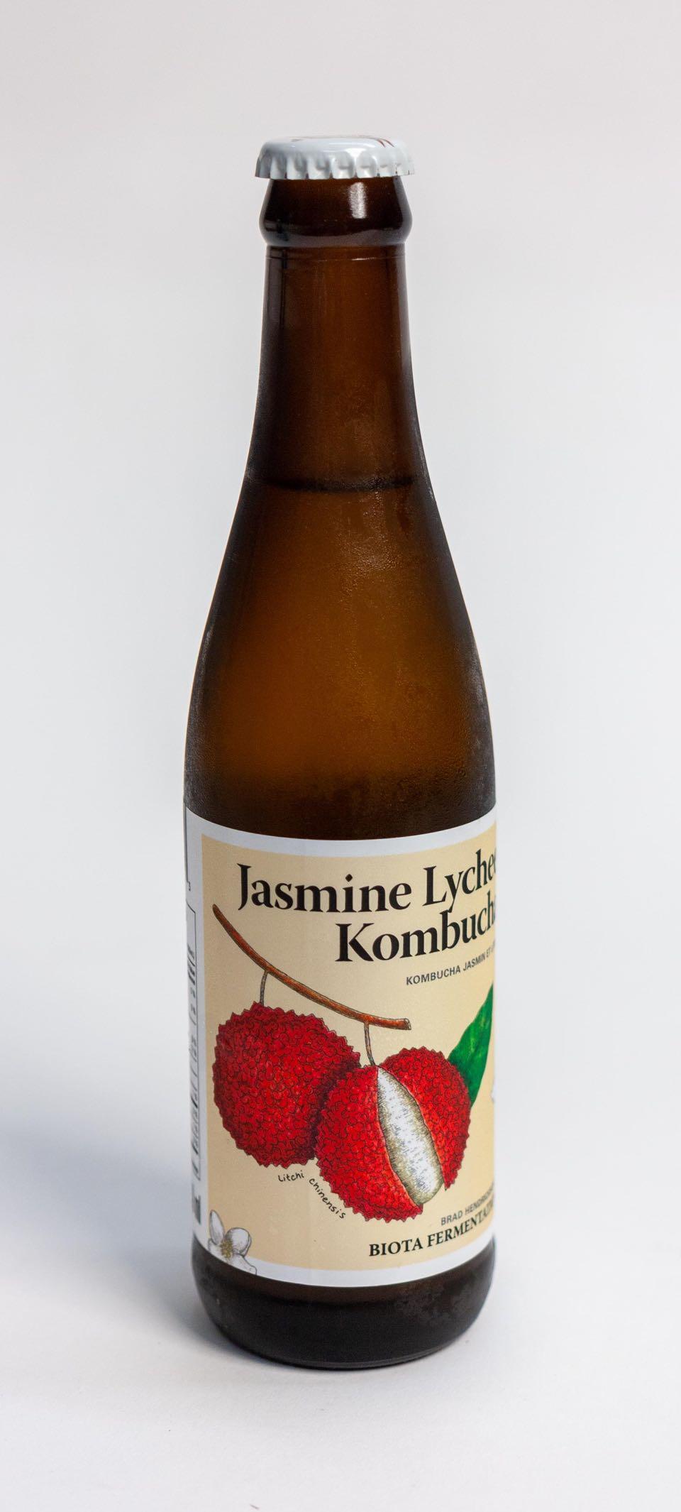 Biota Fermentation Jasmine Lychee Kombucha in 330ml bottle with vibrant red lychee illustration by Jessica Fraser — by Dima.