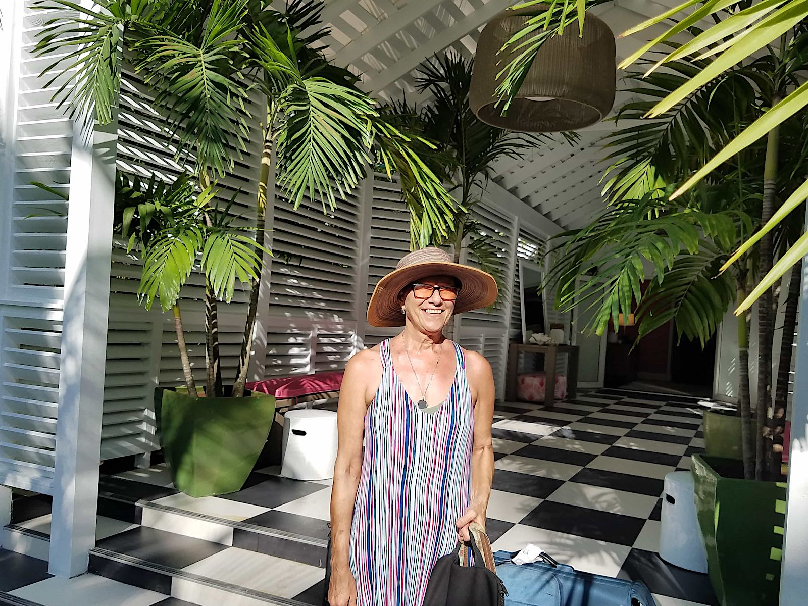 gail in the lobby of a tropical resort
