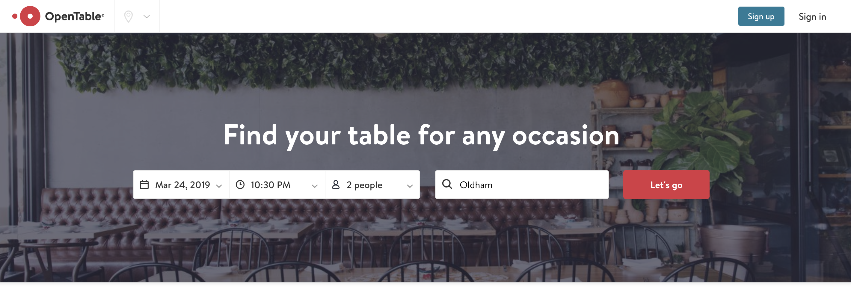 The home page above the fold on OpenTable.com