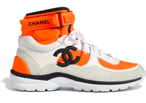 Chanel White Orange Sneaker from poshmark.com