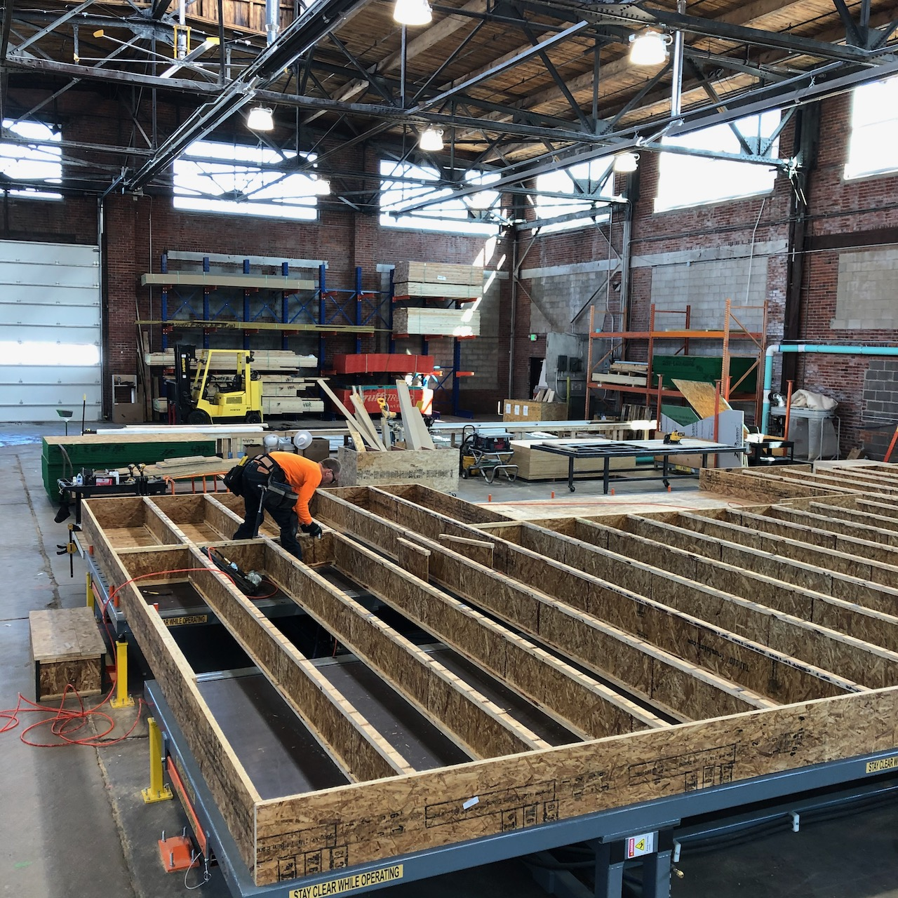 Prefabricated floor cassettes under construction in Simple Homes' Denver factory