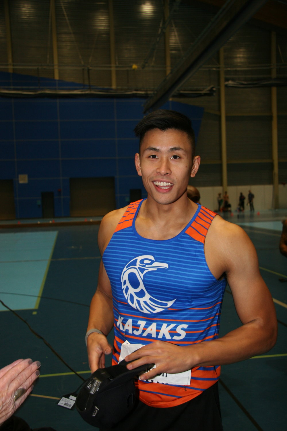 Jackson Cheung with new meet record in 60m hurdles