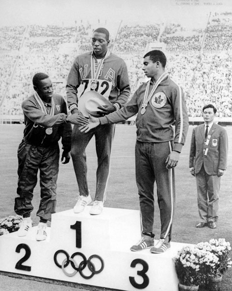 Harry Jerome receives Olympic bronze medal in 1964 with Bob Hayes, USA-gold and Enrique Figuerola, Cuba-silver