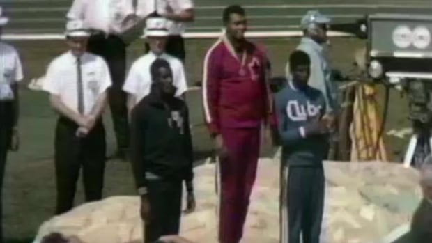 Harry Jerome receives his gold medal at the 1967 Pan Am Games
