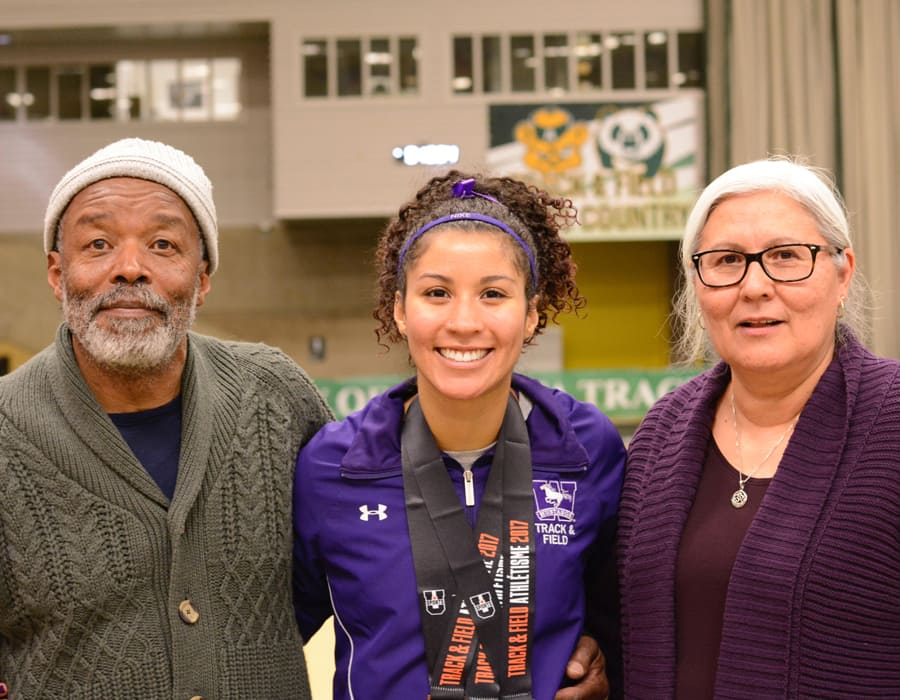 SpearChief-Morris flanked by her parents after a 2017 competition. (Submitted by SpearChief-Morris)