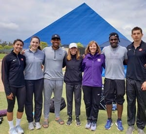 SpearChief-Morris, left, at the 2019 Long Beach Invitationals. pictured alongside her training group and  coach Vickie Croley, third from right. (Submitted by SpearChief-Morris)