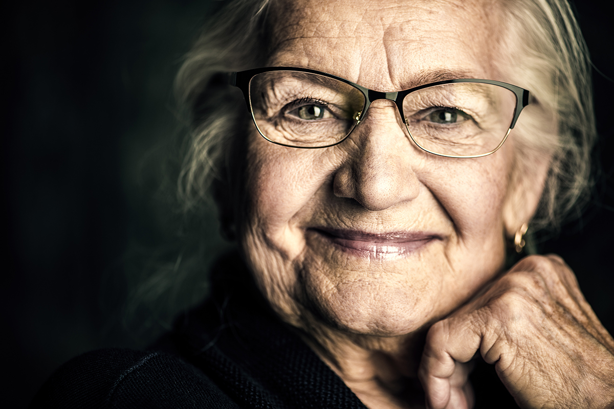 Portrait of a smiling senior woman with glasses