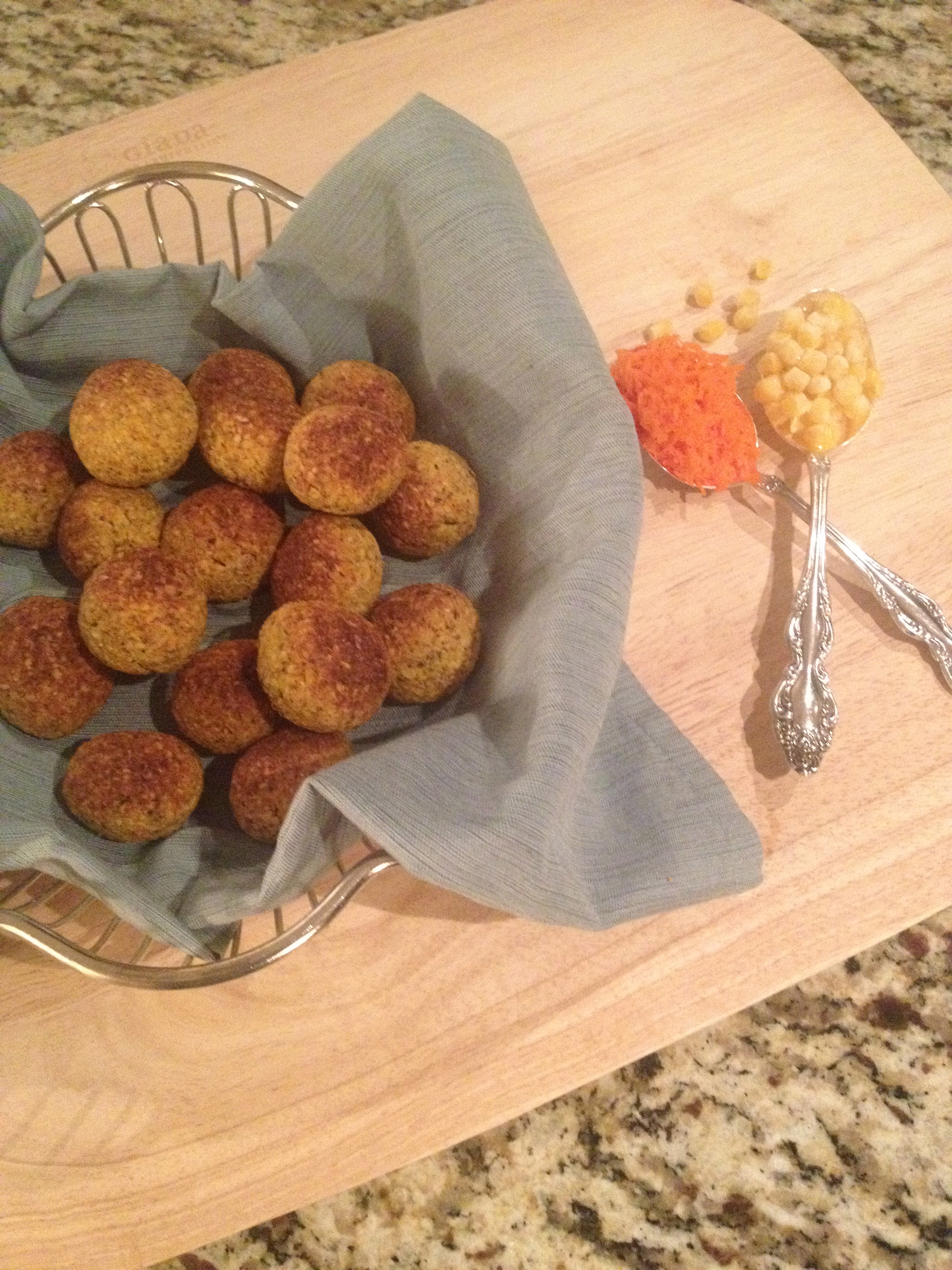 Healthy carrot corn fritters in a basket