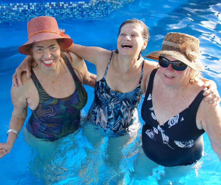 Three older women in a swimming pool