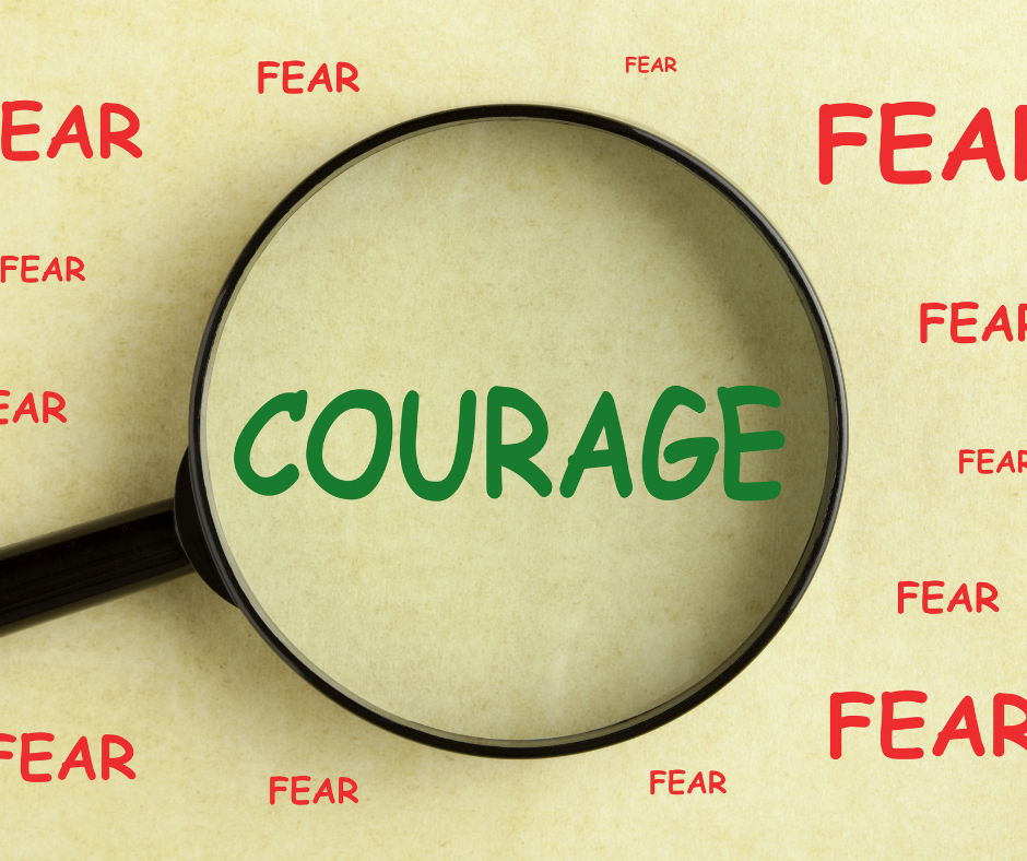 """The word """"courage"""" magnified and surrounded by the word """"fear."""""""