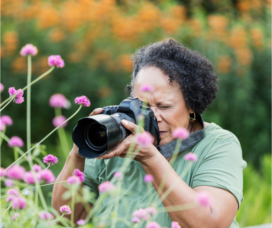 A woman photographing flowers in nature