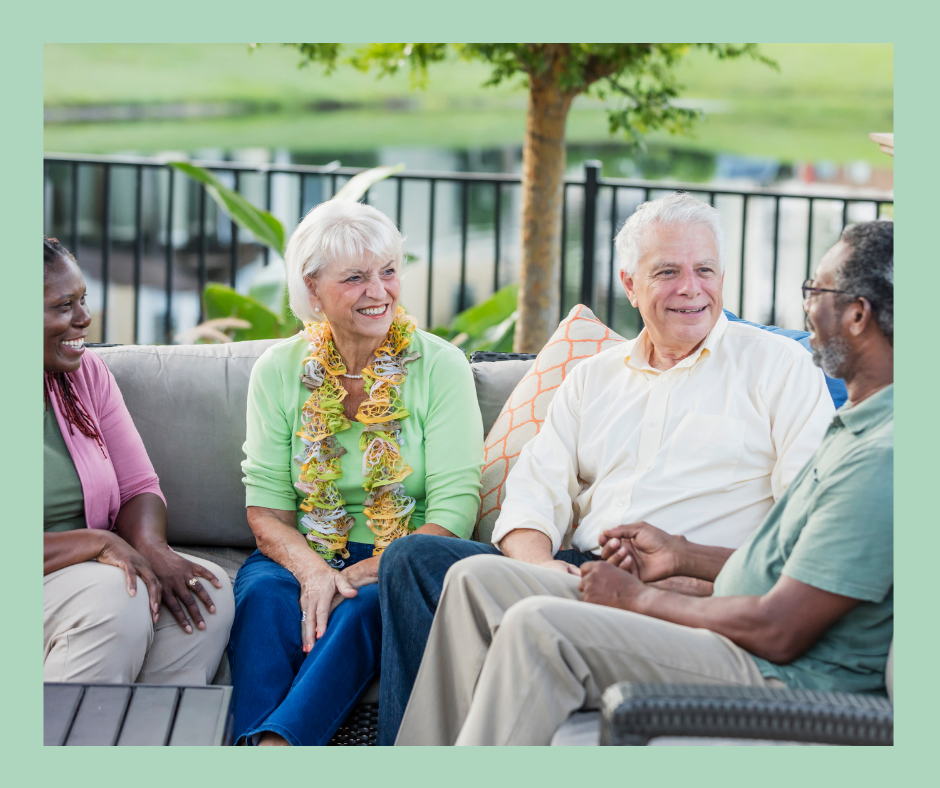 Two older couples from different racial backgrounds having a conversation