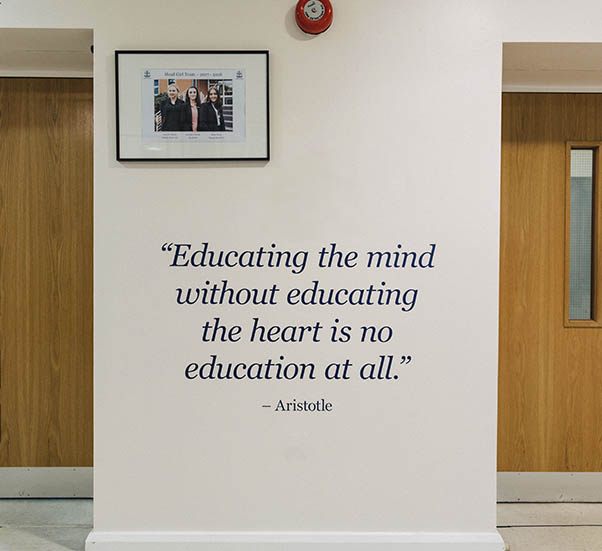 A photo of a vinyl lettering quote on the walls of Alderley Edge School For Girls