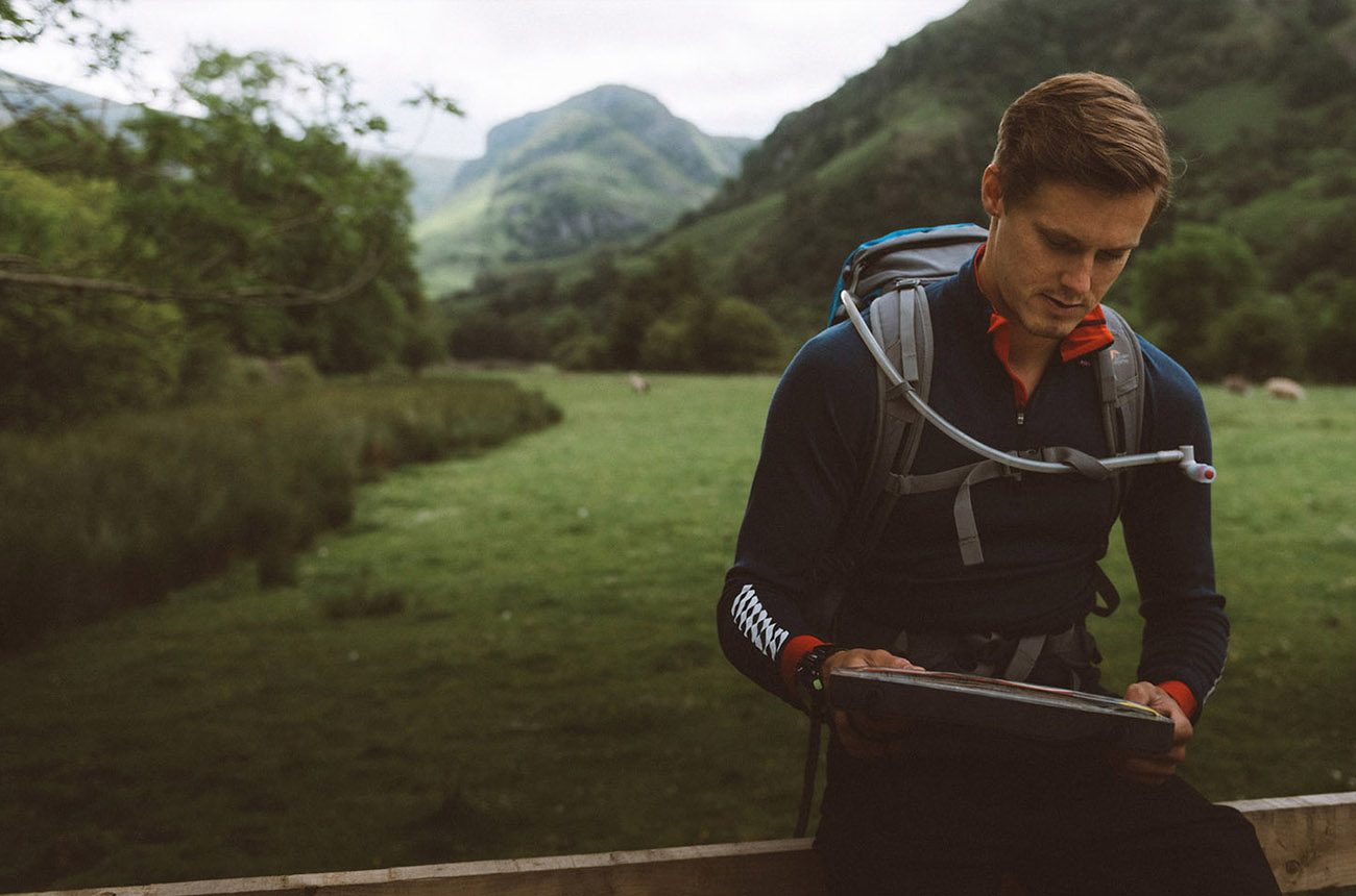 Photo of Chris Seed in the Lake District reading a map