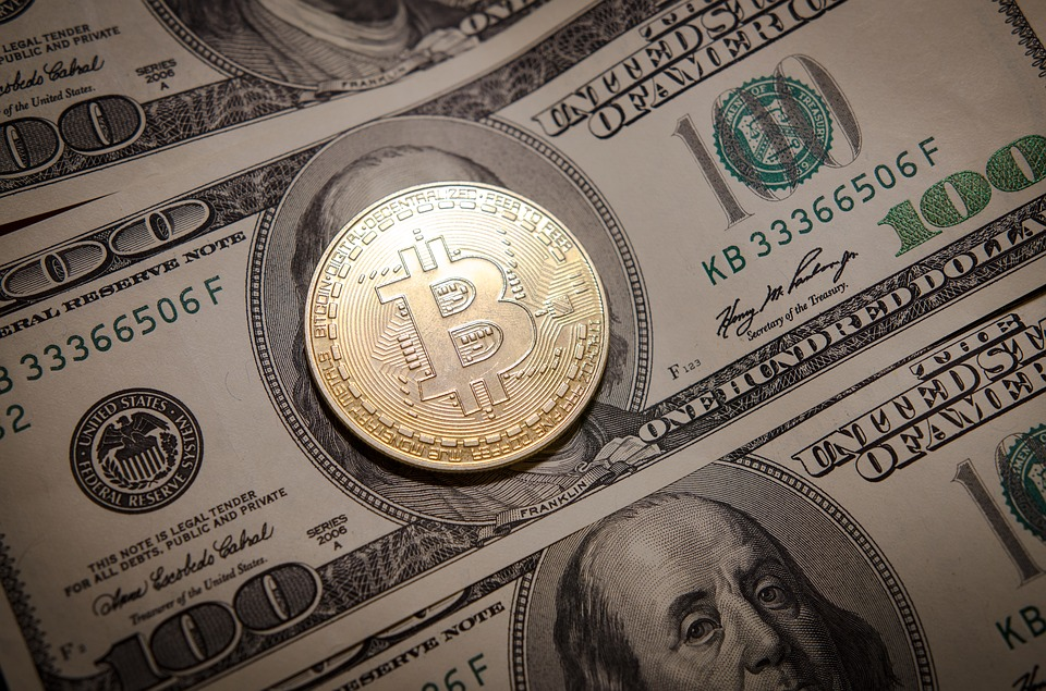 Bitcoin lies on dollar bills