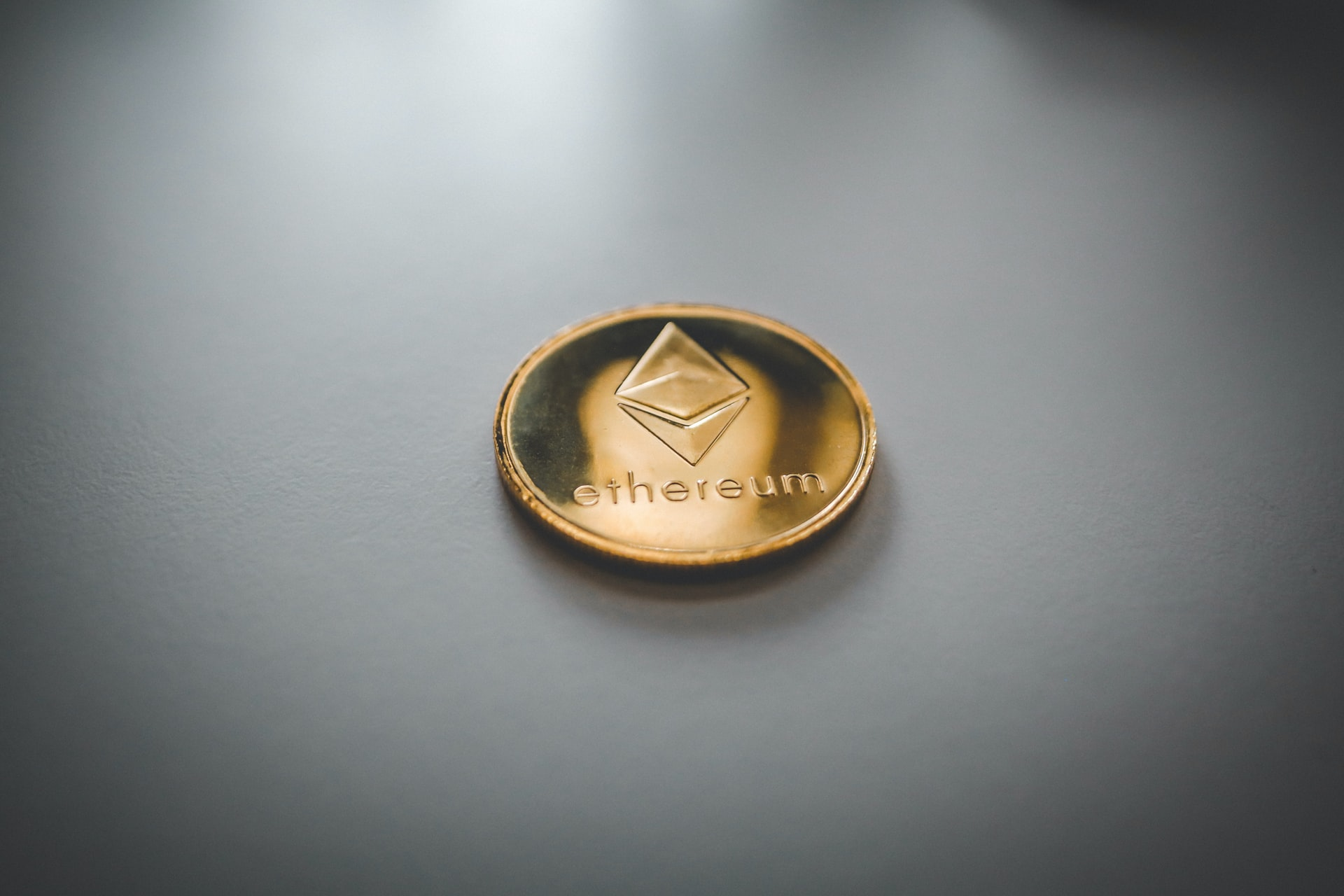 Ethereum coin on table