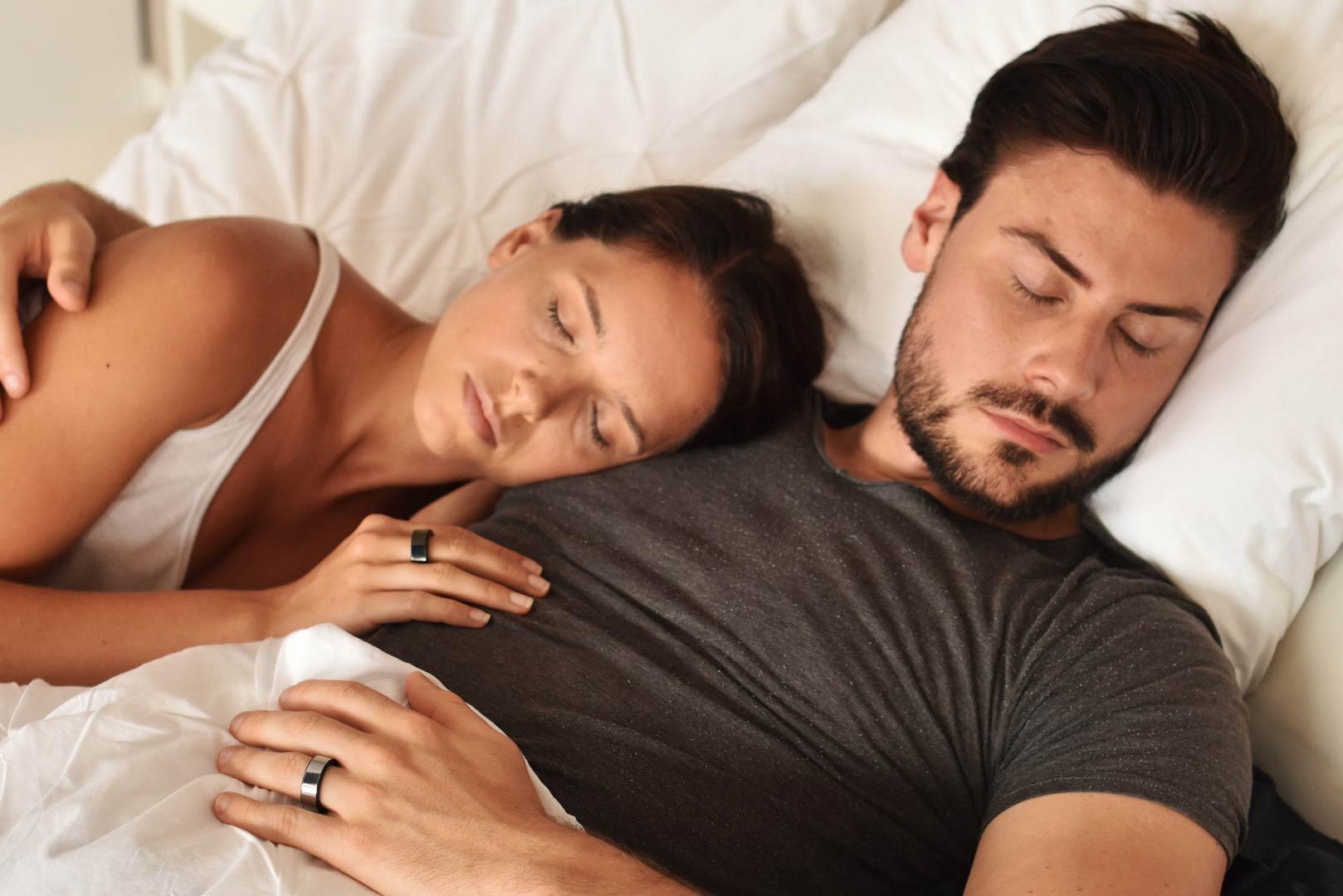 Couple sleeping with Circular Ring