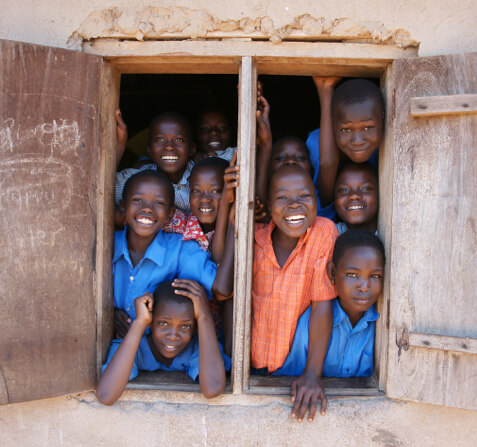 Taken in a school in Uganda. This youn boys were so happy to have their picture taken. This was at a God Loves Kids school.