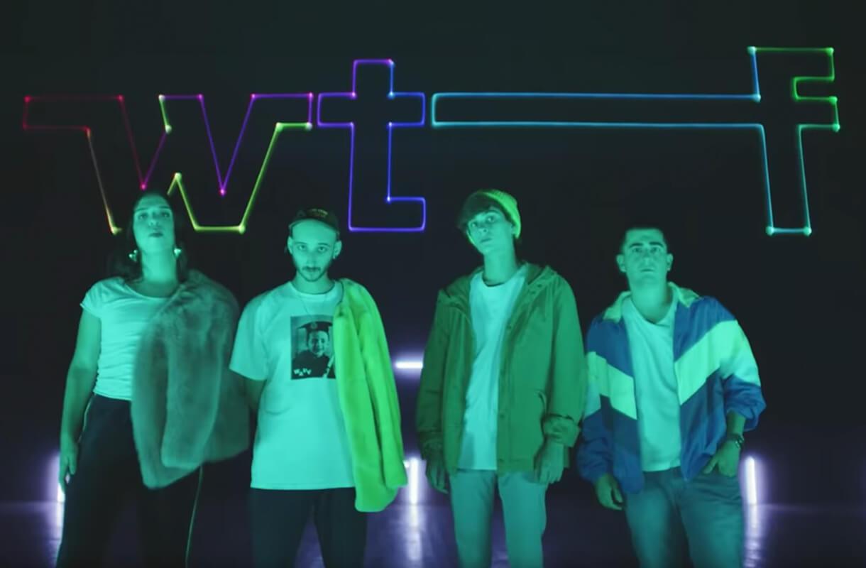 Кадр из видео для бренда WTF с молодыми людьми на фоне неонового логотипа