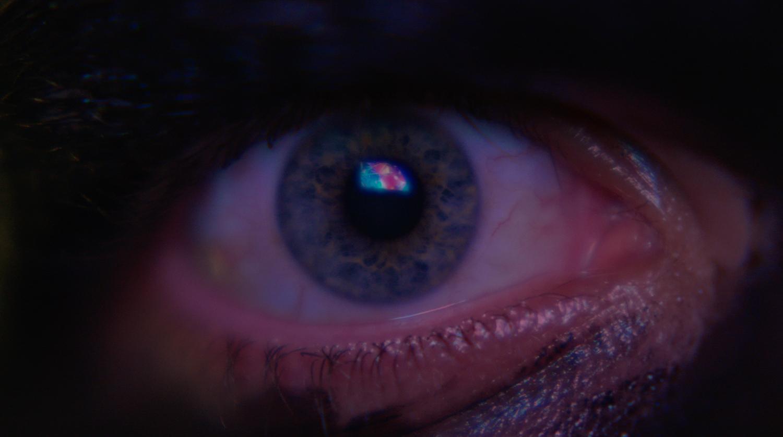 official still from a music video, a close-up of an eye