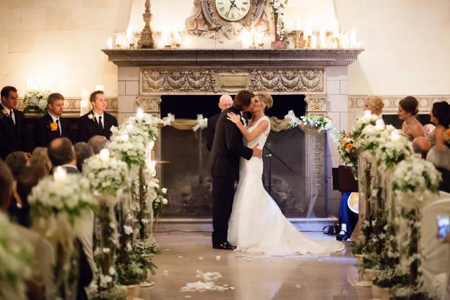 Bride and groom kissing at the Saint Paul Athletic Club