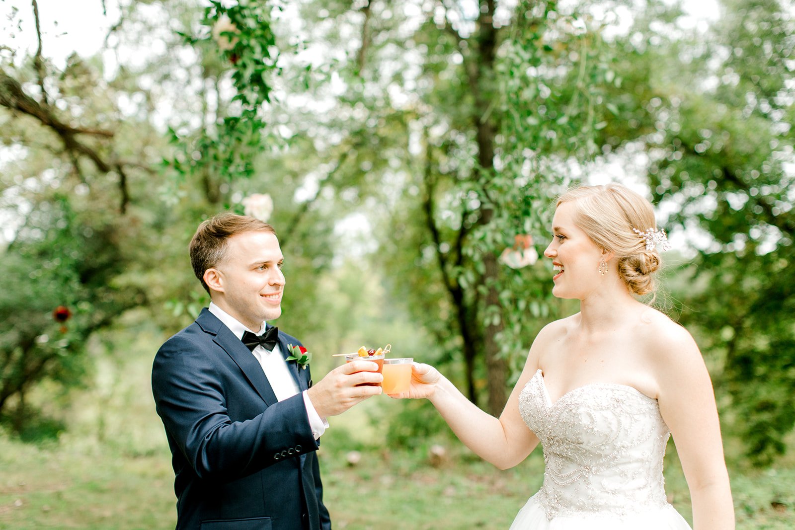 Bridge and groom holding drinks