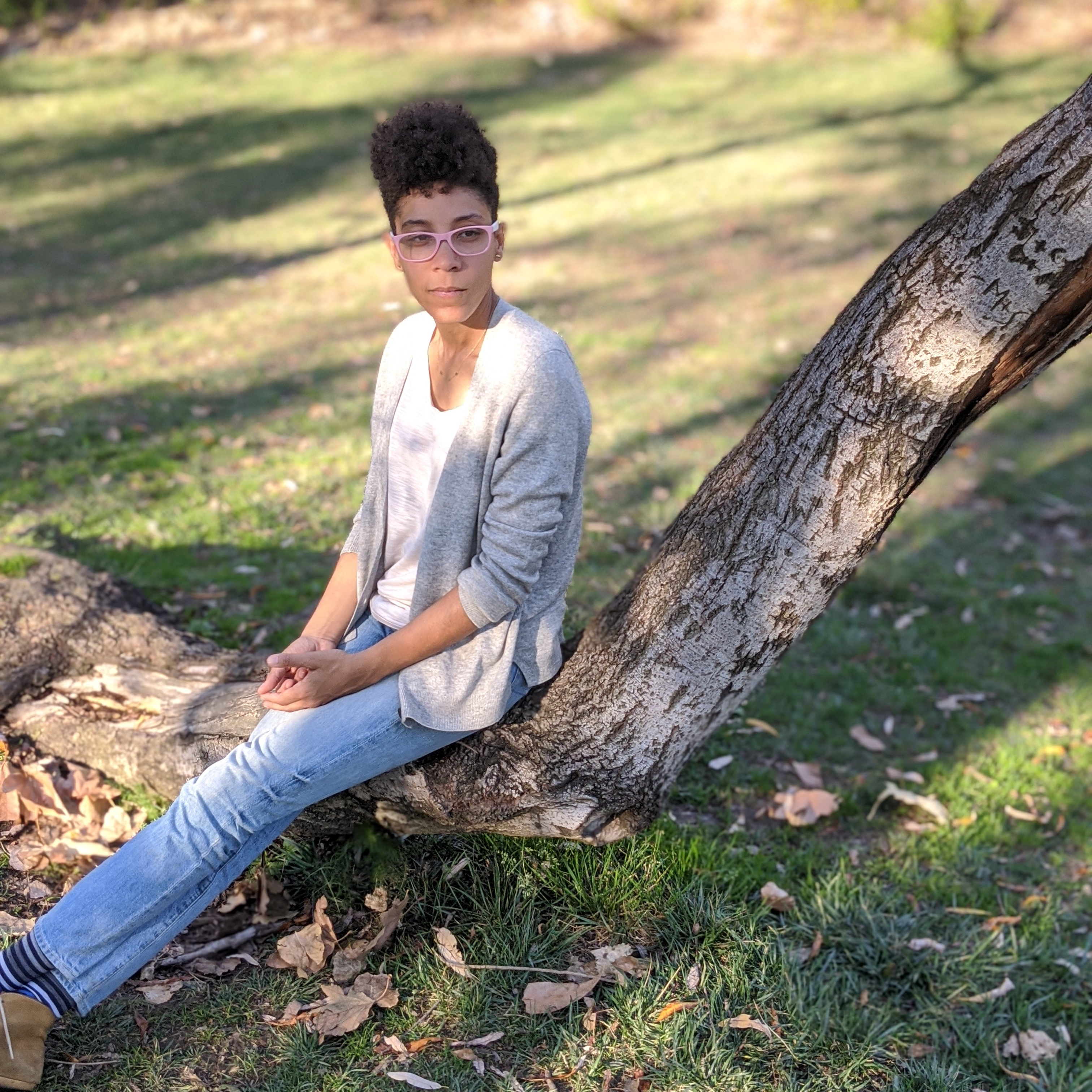 Jamie Renee Williams sitting on fallen tree limb