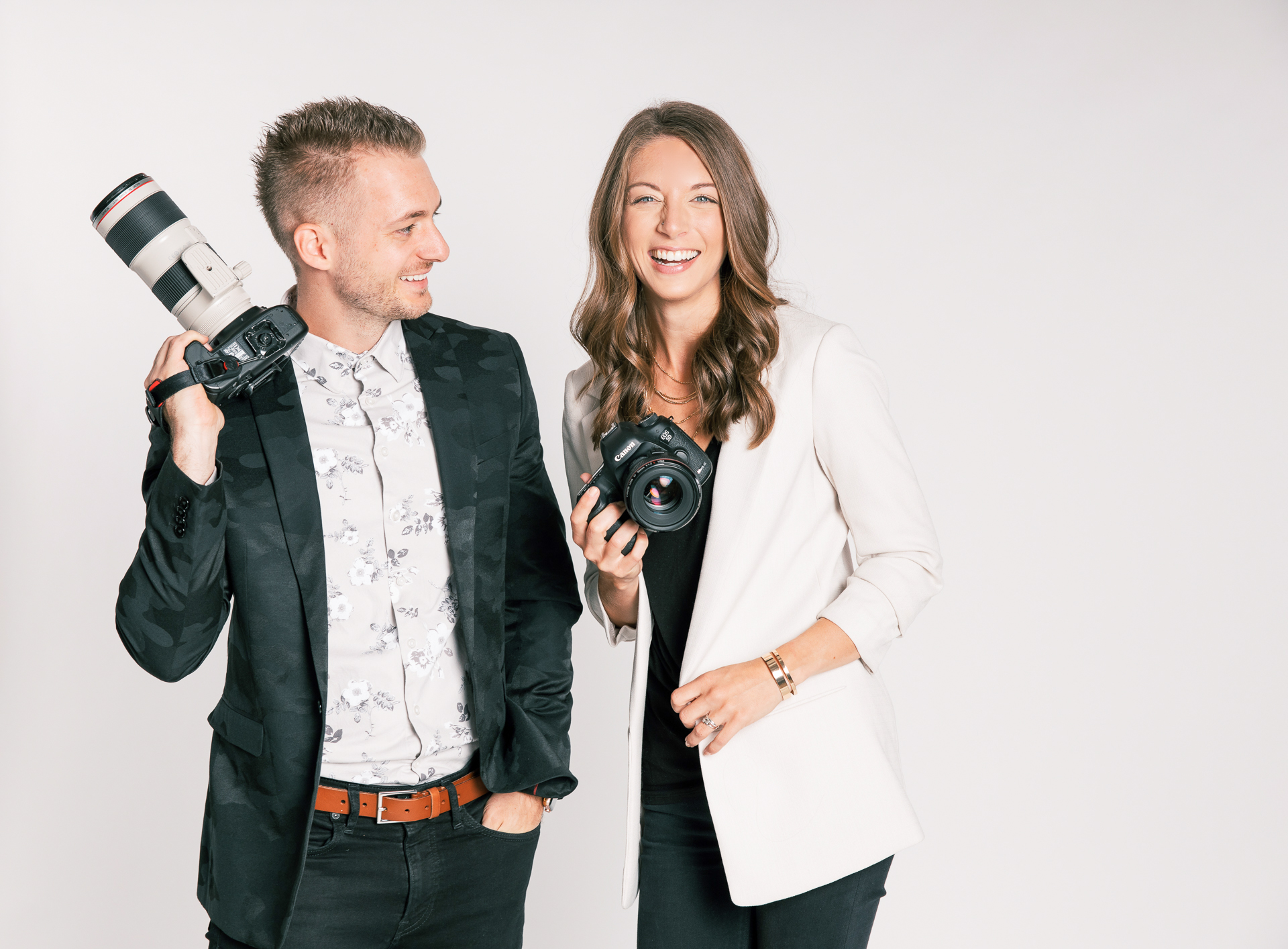 Kaleb and Becky Dean, Owners and Founders of Pen and Lens in Ray Ban Sunglasses