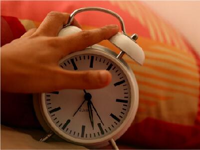 Hand on alarm clock