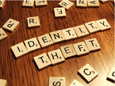 Scrabble letters spelling out identity theft