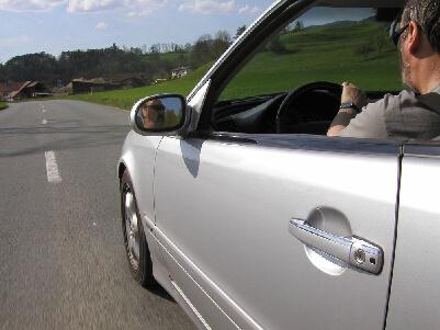 Guy driving in rental car