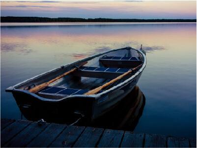 Small rowboat docked at sunset