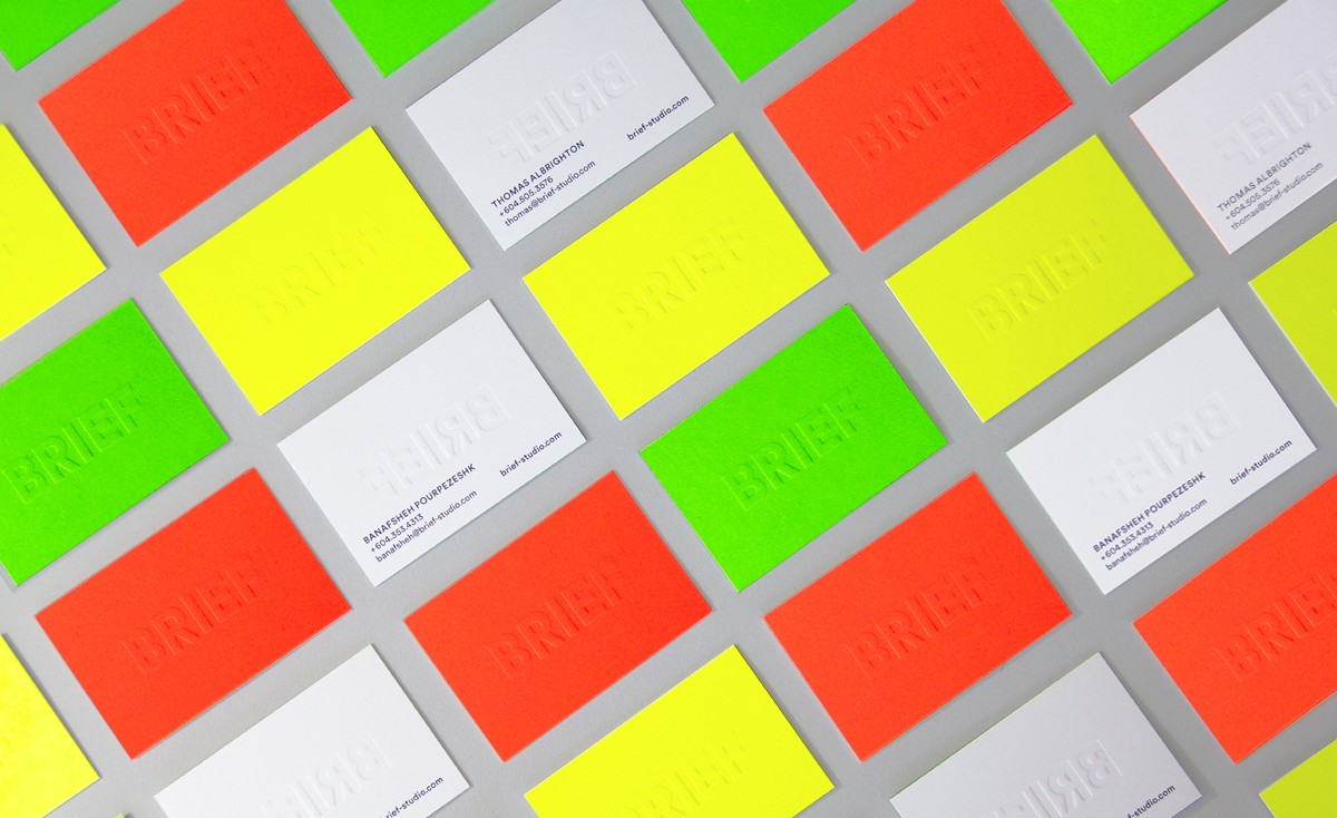 vibrant brief embossed business cards in green yellow orange and white