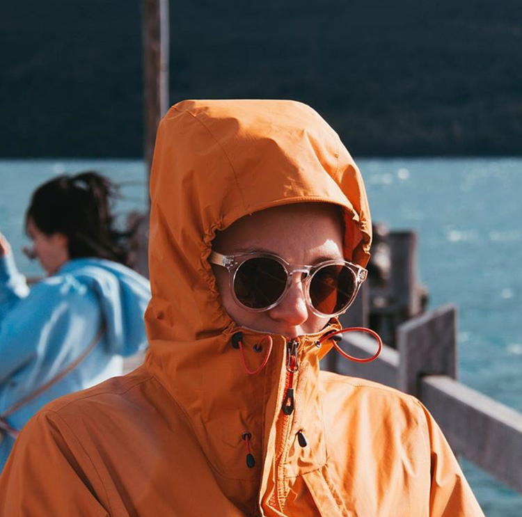 A funny portrait photo of me in a yellow rain jacket, tightened around my face. Only my sunglasses visible. Looking like that scene from Mean Girls.