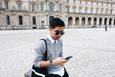 Guy checking phone