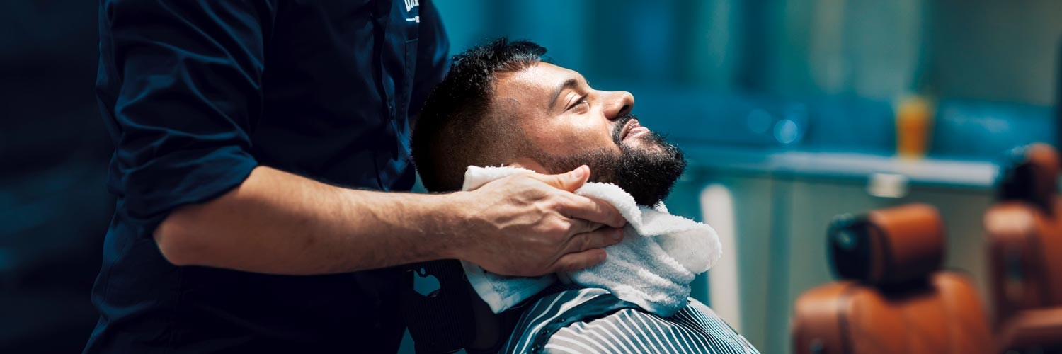 Man getting cut and shave