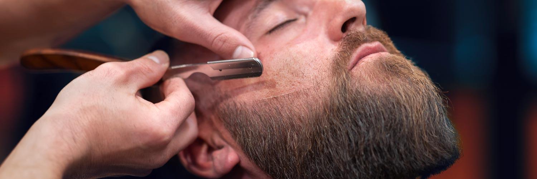Shaving man's beard