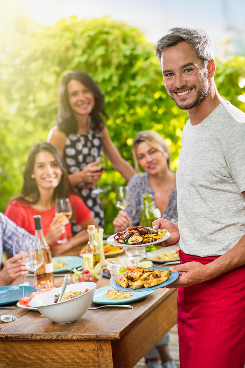 Friends enjoying a backyard cookout.