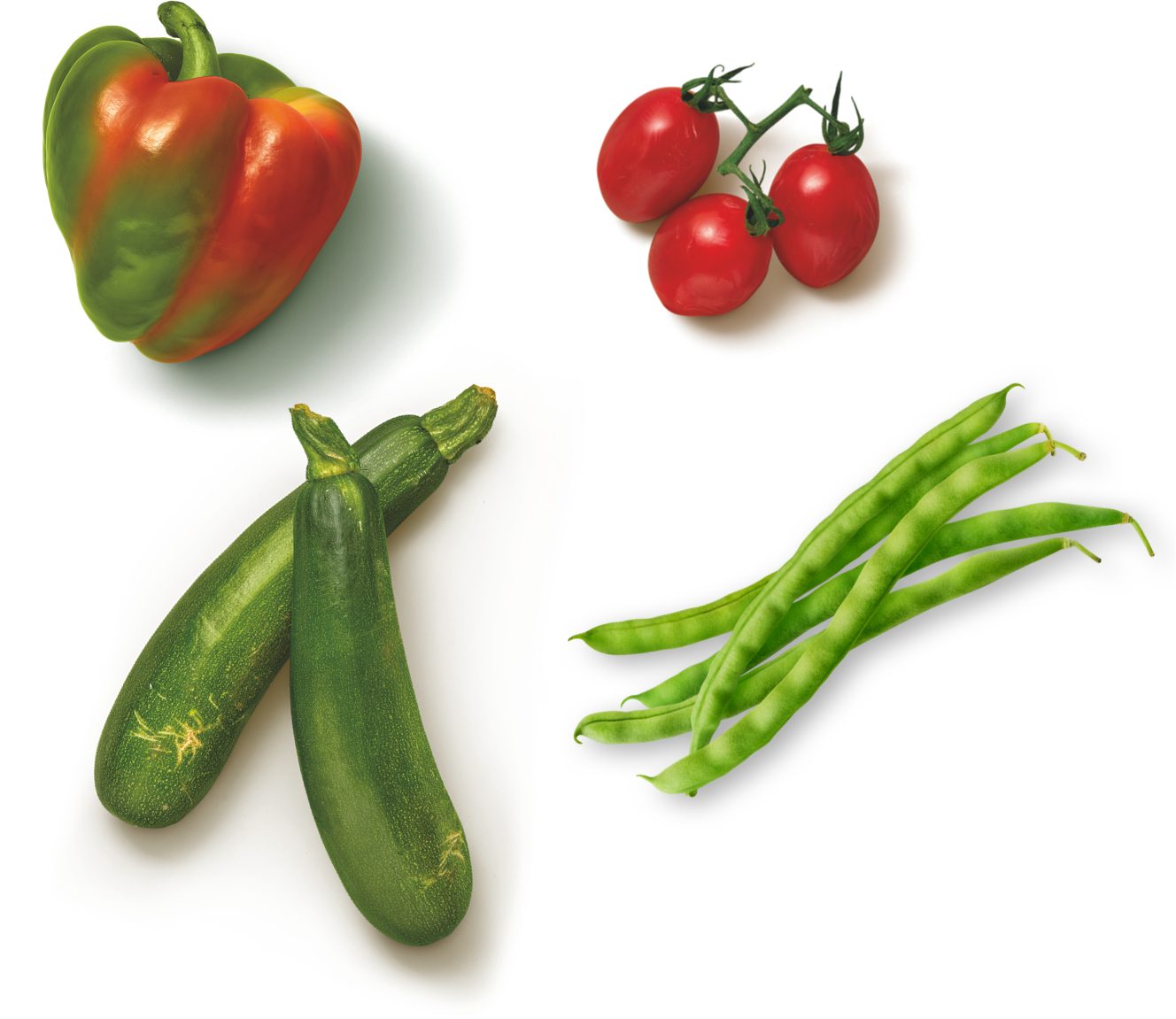 Veggies you will find in Dirt Kitchen Snacks: blushed peppers, zucchini, grape tomatoes, and greenbeans.