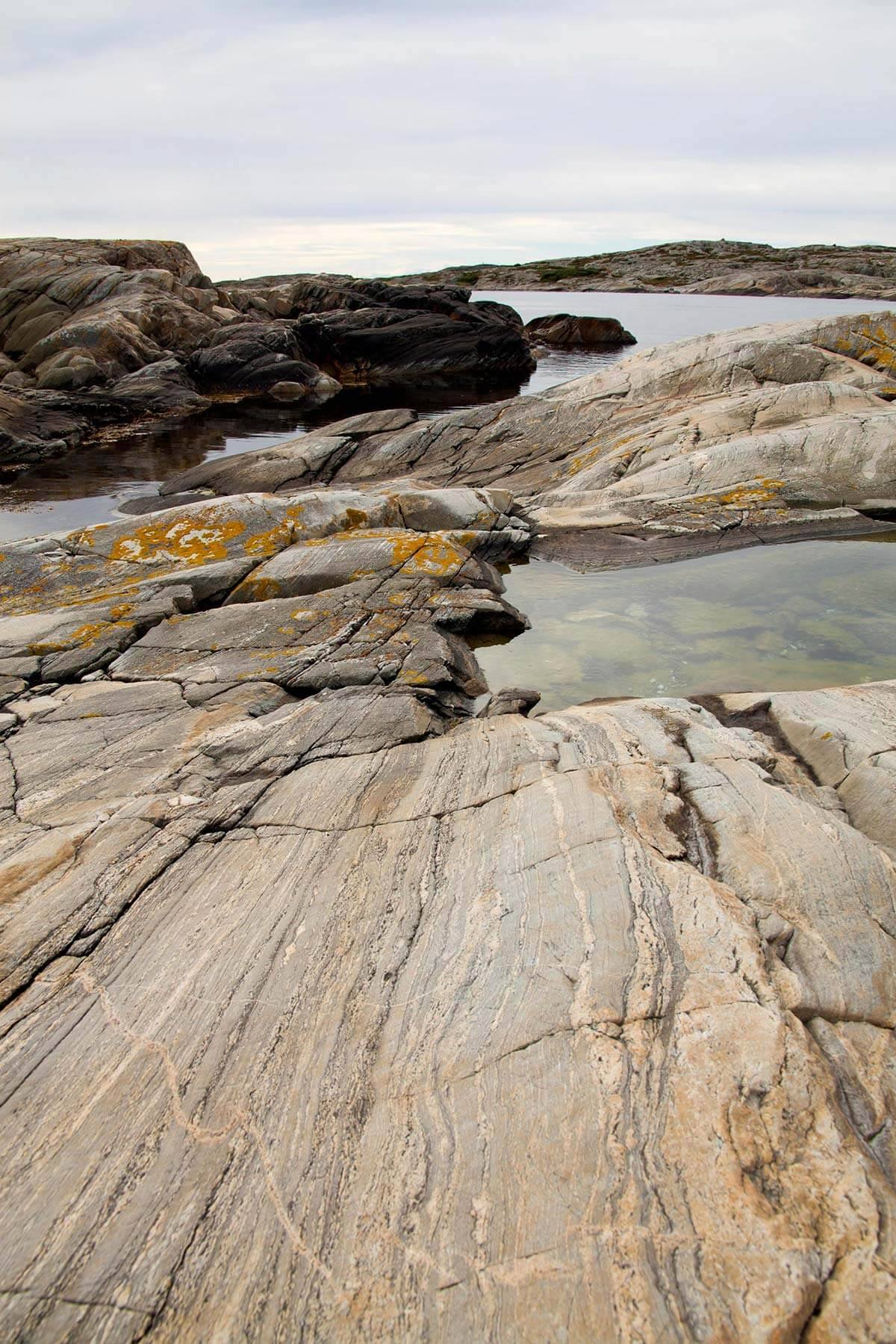 A view of the coastline along the Swedish west coast, showing rock formations emerging from the water