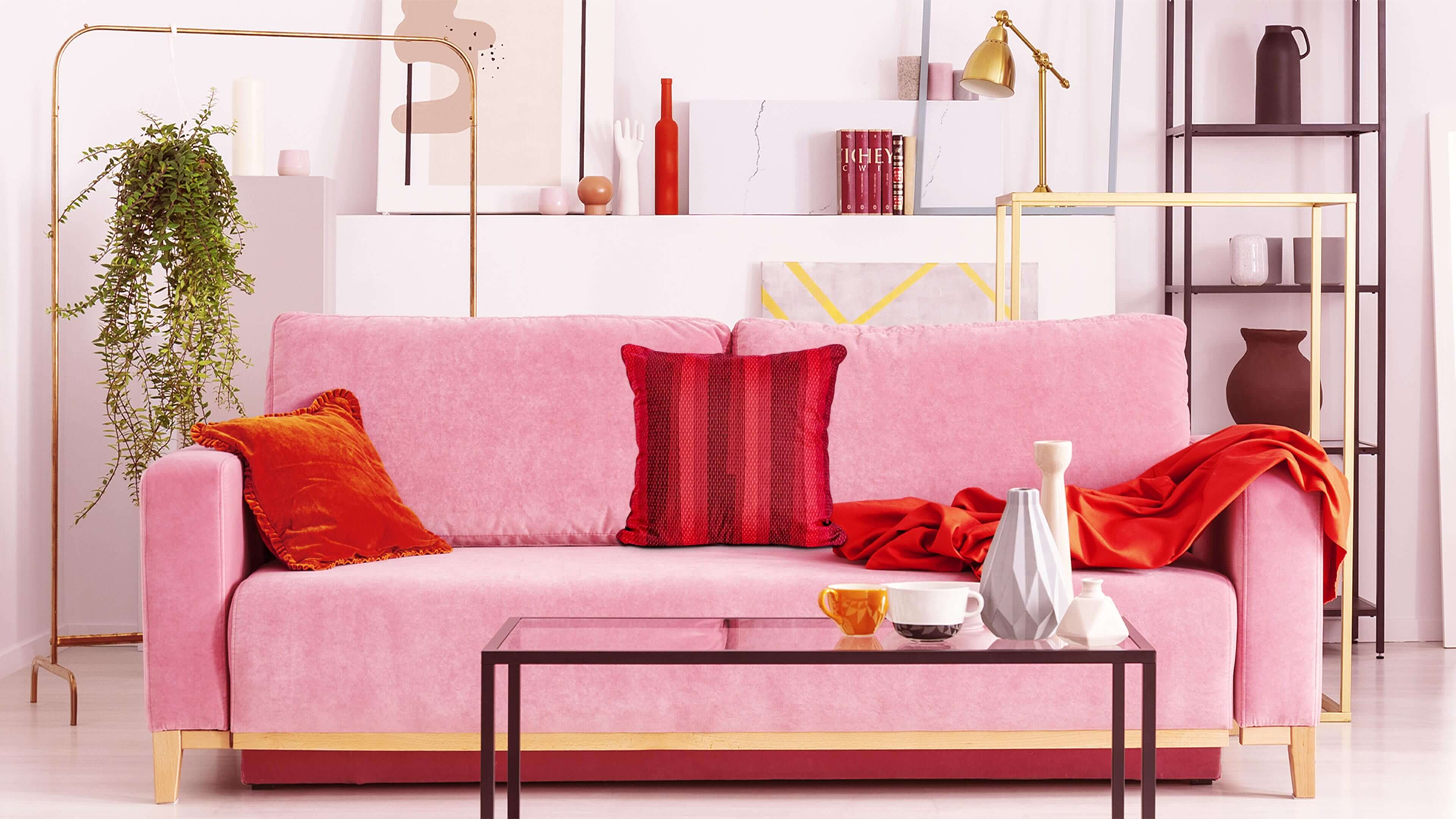 Red faux suede throw pillow on pink living room couch