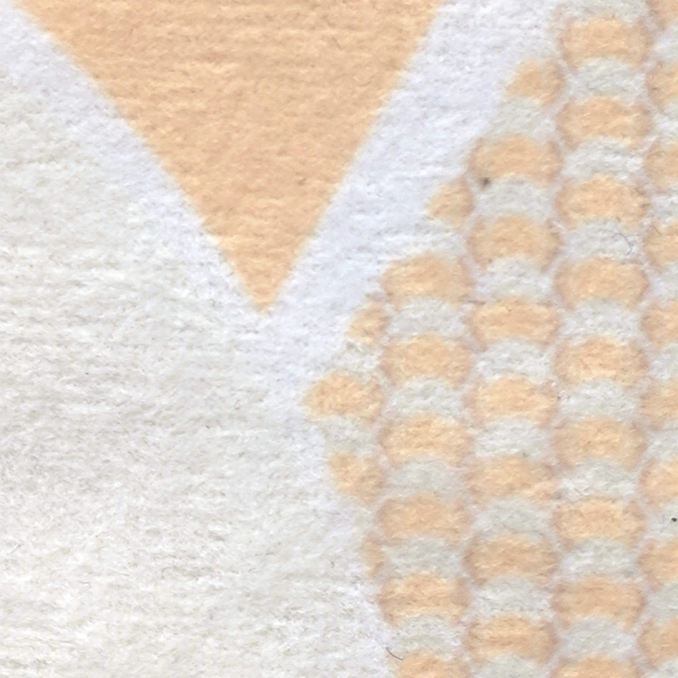 Fabric swatch for white, ivory and peach faux suede throw pillow