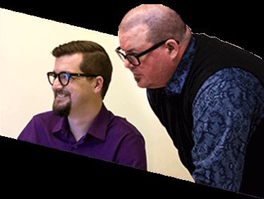 Photo of two Blueshift employees chatting.