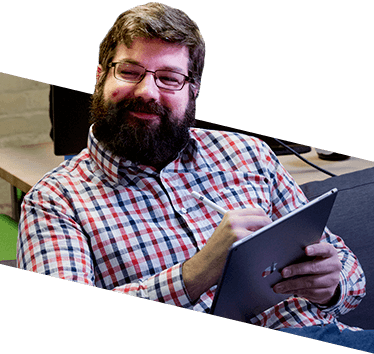 Photo of a Blueshift employee using a tablet.